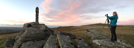 Anna photographing a stunning sunset from Brat Tor, Dartmoor