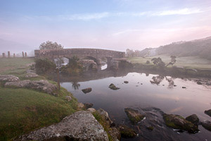 Clapper bridge shrouded in mist at Bellever, Dartmoor