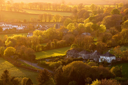 Brentor village bathed in golden light