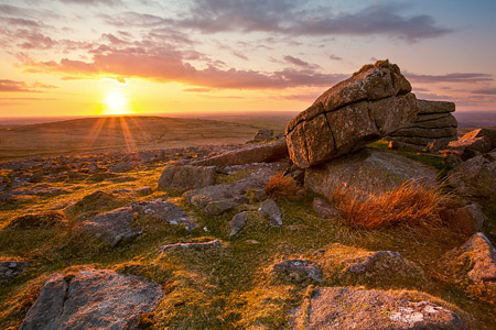 Golden sunset illuminates the landscape. Rowtor, Dartmoor