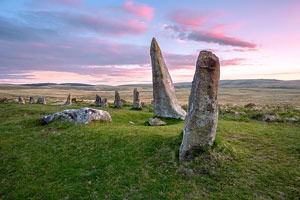 Beautiful pink clouds after sunset over Scorhill Stone Circle, Dartmoor